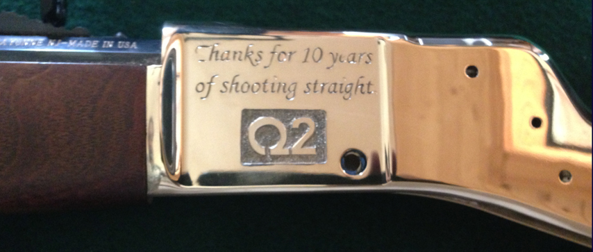 Left Side of Henry Rifle engraved with Q2 Bank Logo